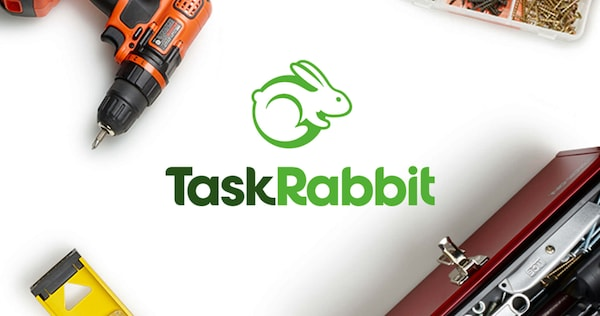 A banner image with an electric drill, a toolbox and screws on a table for TaskRabbit assembly services.