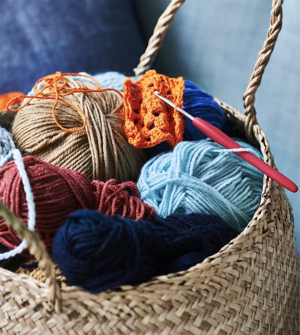 A basket filled with colorful yarn.
