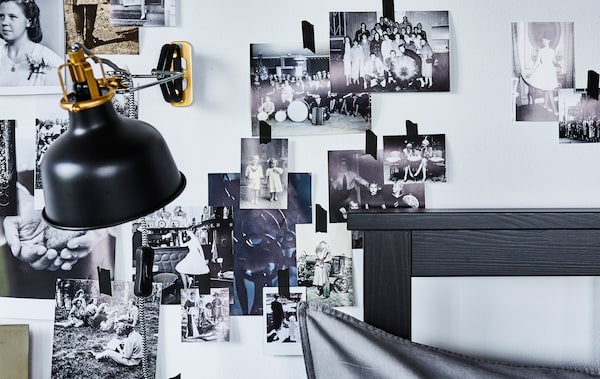 A bedroom with a photo collage on the wall