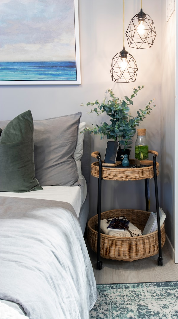 A bedroom with a trolly on the side
