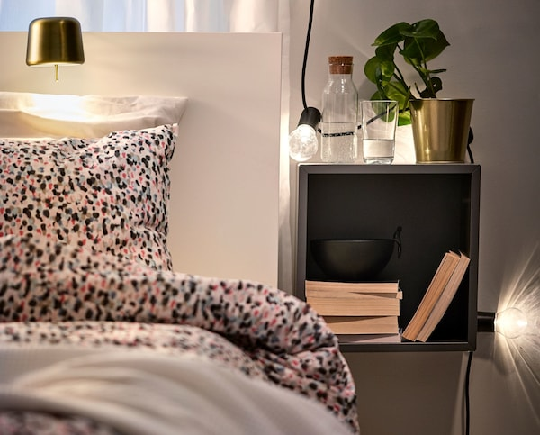 A bedside table with task lighting.