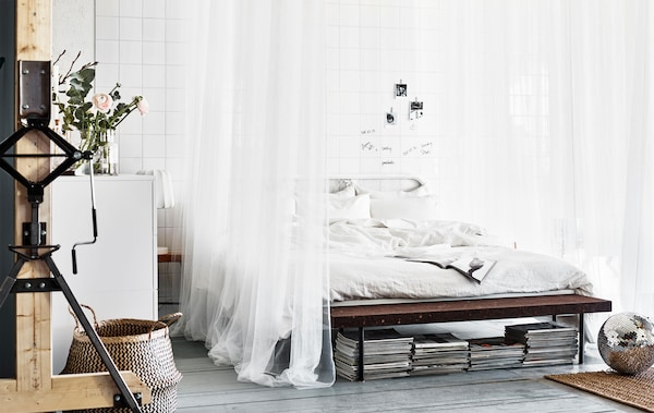 A big white bed, crisp sheets and pillows, draping textiles. What's your dream bedroom?