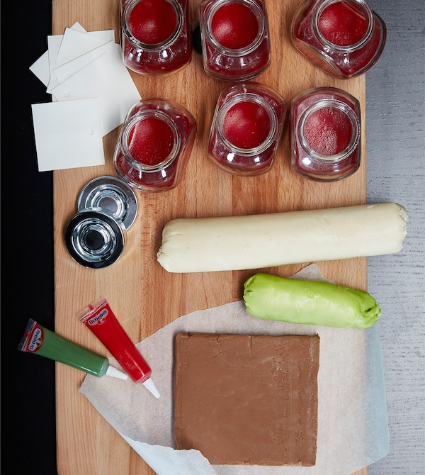 A bird's-eye view of the ingredients for eyeball treats laid out on baking surface.