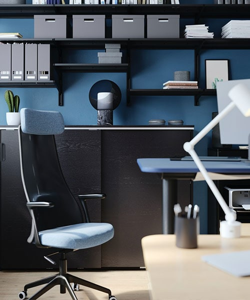 A black and blue hued office.