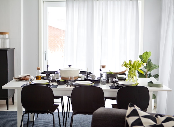 A black-and-white dining table and chairs.