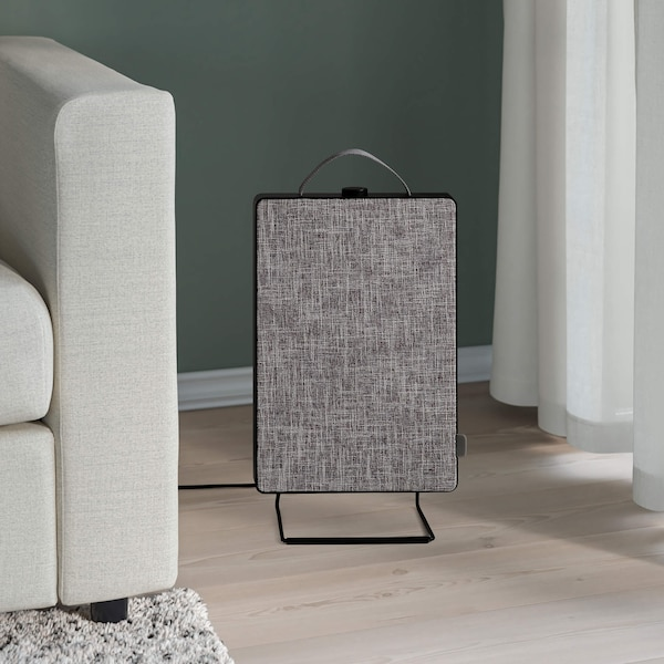 A black FÖRNUFTIG air purifier in a living room.
