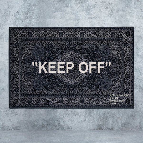 "A black Persian rug with the words ""keep off"" woven on it, designed by Virgil Abloh for IKEA ART EVENT 2019."