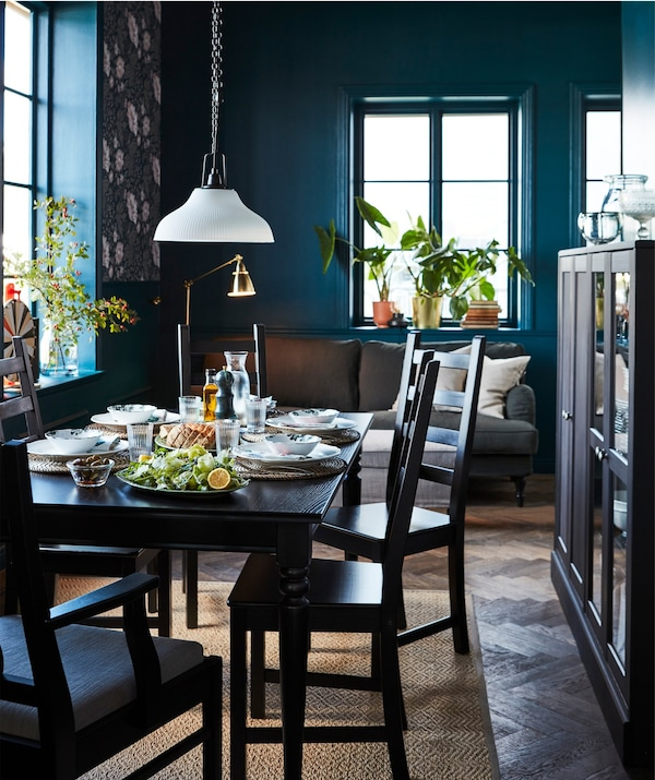 A black, traditional style IKEA INGATORP extendable table in a dining setting.