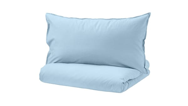 A blue duvet cover set on a white background.
