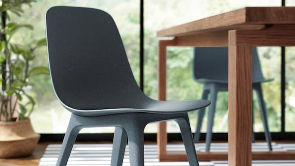 A blue ODGER chair pulled out from the table