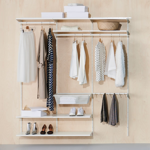 A BOAXEL wardrobe combination with shelves, clothes rails and a mesh basket holding clothes, shoes, boxes and a basket.