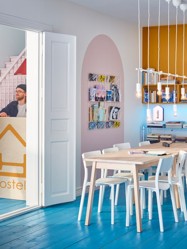 A bright and cheerful dining area in a hostel.