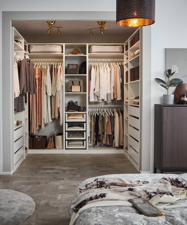 A bright bedroom with IKEA PAX open wardrobe.