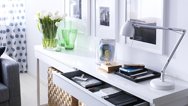 A bright home office featuring a white desk
