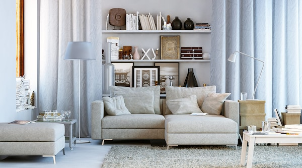 A bright living room featuring a big sectional sofa