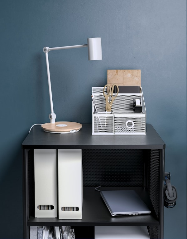 A cabinet which has file organiser, desk organiser and also a white work lamp