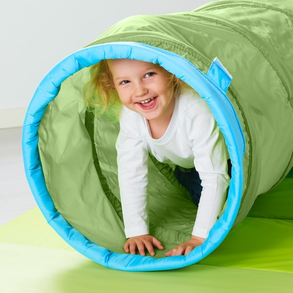 A child playing in a play tunnel.