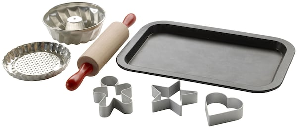 A children's baking set with rolling pin, pastry cutters and baking tray.