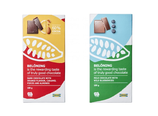 A chocolate bar with red and orange packaging and a chocolate bar with green and blue packaging.