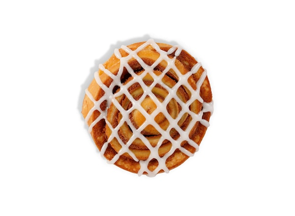 A cinnamon bun viewed from above against a white background.