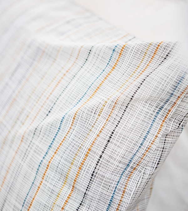 A close-up image of a simple striped pillow.