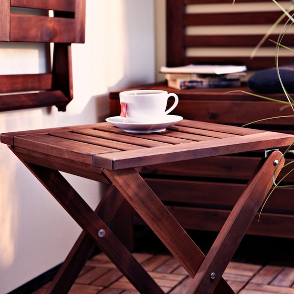 A close up image of the APPLARO wooden stool.