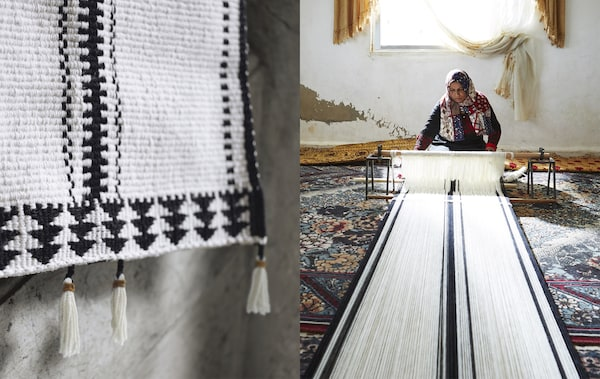 A close-up of a black and white patterened rug and a  woman working at a loom.