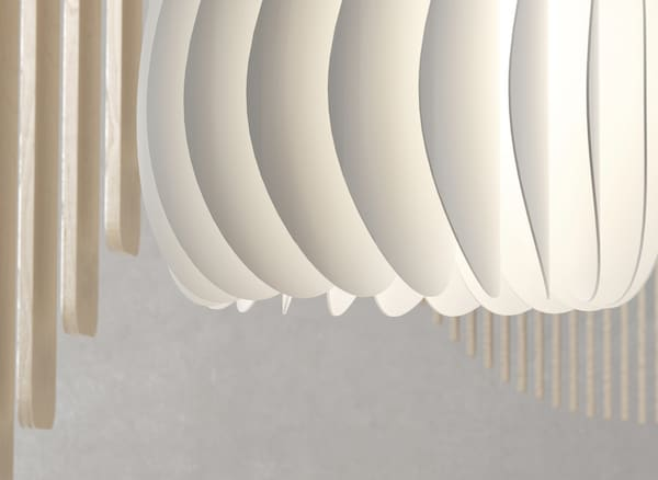 A close-up of a curved white lampshade.