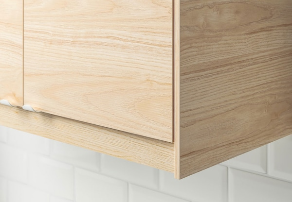 A close up of a kitchen cabinet with IKEA ASKERSUND doors.