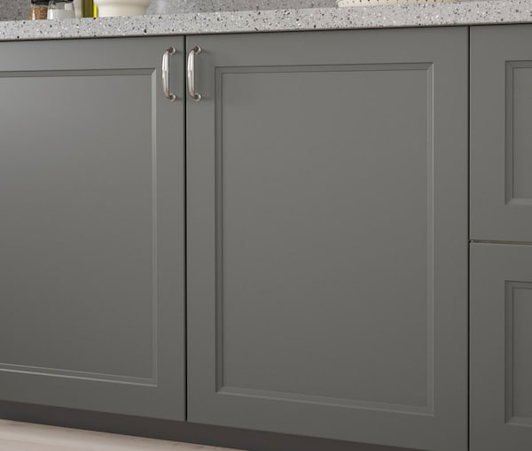 A close up of a kitchen cabinet with IKEA AXSTAD grey doors.