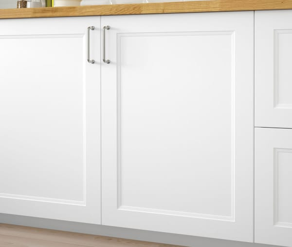 A close up of a kitchen cabinet with IKEA AXSTAD white doors.