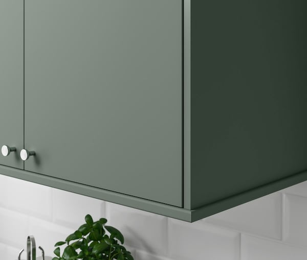 A close up of a kitchen cabinet with IKEA BODARP doors.
