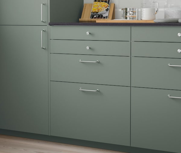 A close up of a kitchen cabinet with IKEA BODARP drawers.