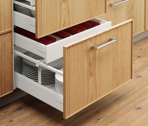 A close up of a kitchen cabinet with IKEA EKESTAD drawers.