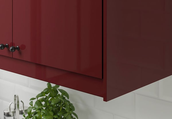 A close up of a kitchen cabinet with IKEA KALLARP doors.
