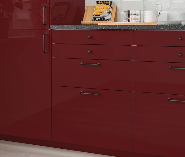 A close up of a kitchen cabinet with IKEA KALLARP drawers.
