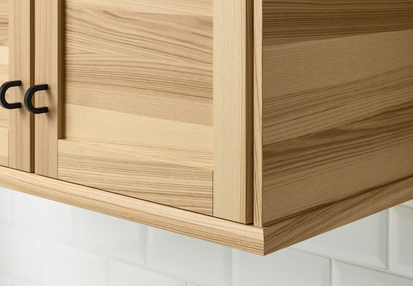 A close up of a kitchen cabinet with IKEA TORHAMN doors.