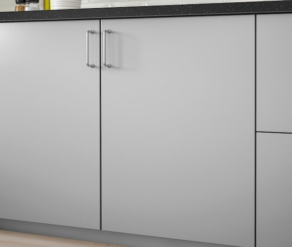 A close up of a kitchen cabinet with IKEA VEDDINGE grey doors.