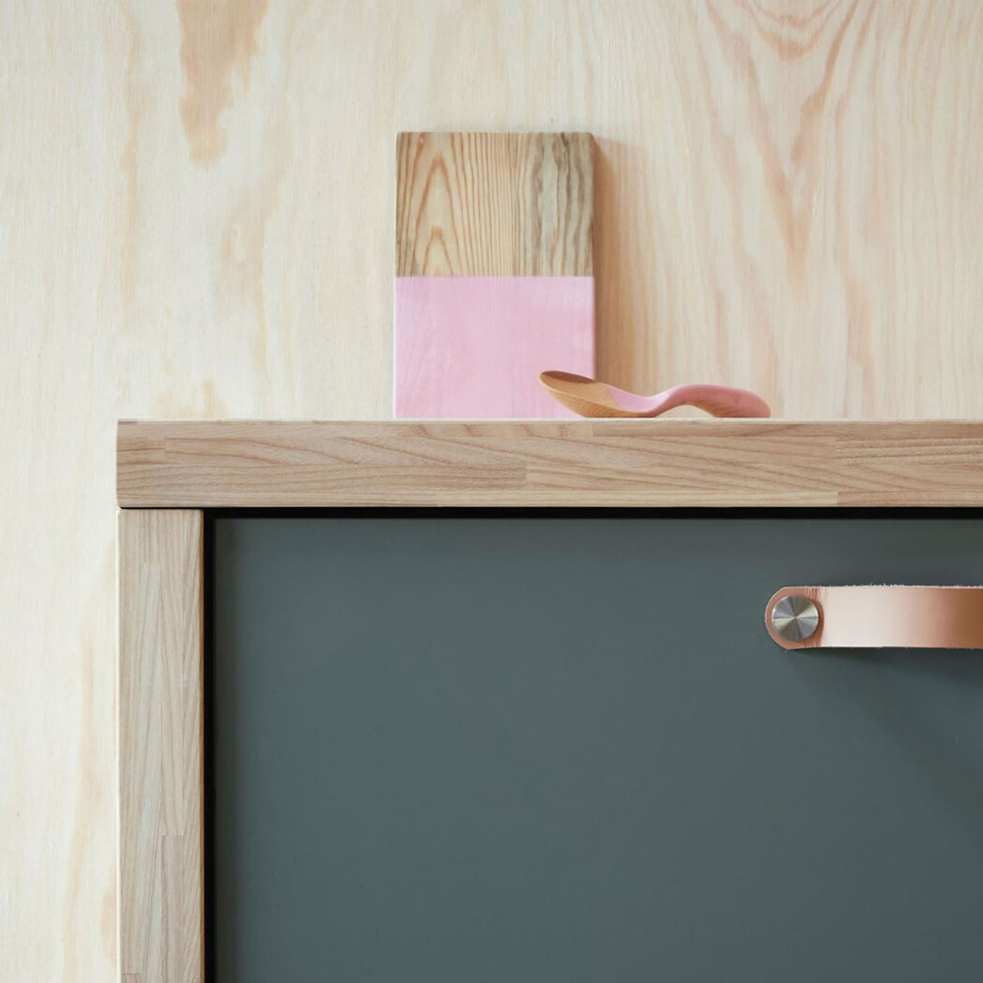 A close-up of a kitchen drawer using BODARP drawer front in a matte grey-green for a modern look.