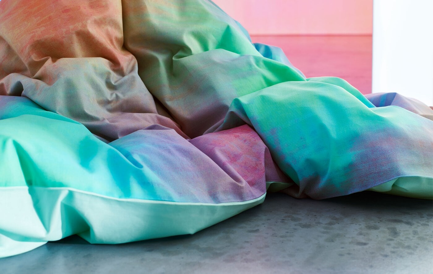 A close-up of a multicolour duvet.