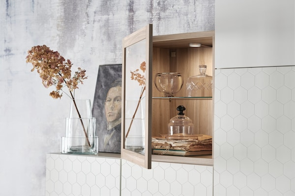 A close up of a SINVIK glass door and BESTA storage system.
