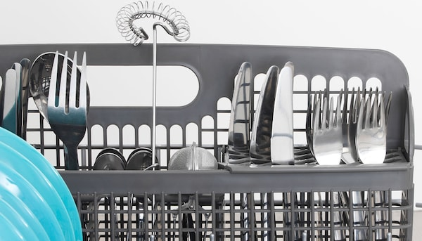 A close up of a SPOLAD dishwasher cutlery drying rack