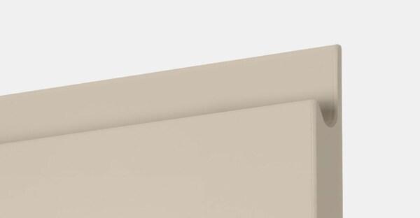 A close up of an IKEA VOXTORP high-gloss light beige handleless door.