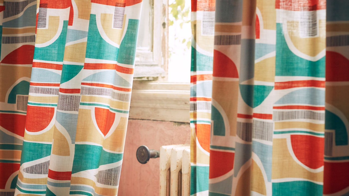 A close-up of MARTORN curtains with a multi-colored graphic pattern that looks like it could be taken from the 1960s.