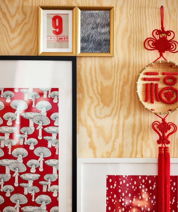 A close-up of picture frames displaying Asian themed images.