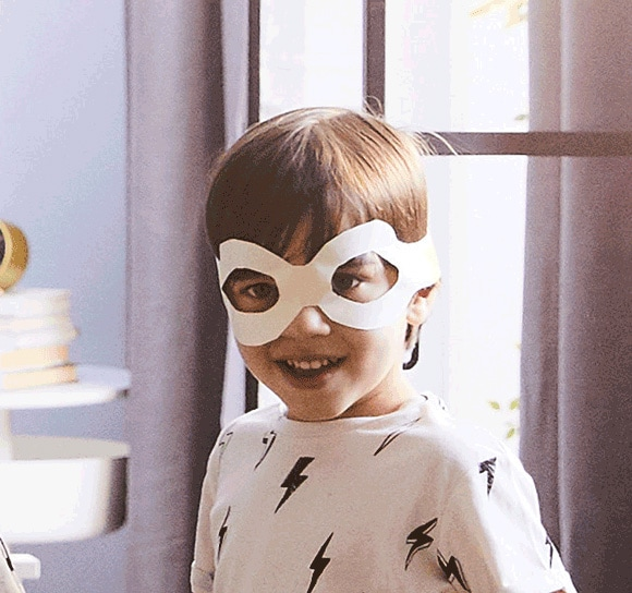 A close-up of the 2019 IKEA Catalogue cover showing a playful child in a paper mask. Check back soon to browse the digital version or order a printed copy.