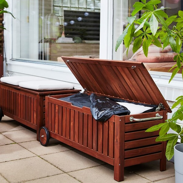 A close up of the APPLARO wood storage bench.