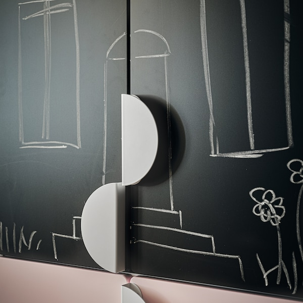 A close-up of the blackboard front of SMÅSTAD wardrobe, including separate half-circle shaped handles for customising with.
