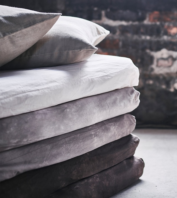 A close-up of the corner of a stack of mattresses made into a sofa-style chaise.