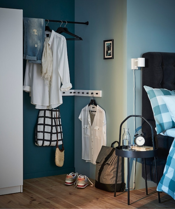 A clothes changing nook created from an awkward space between a closet and the corner of a room.